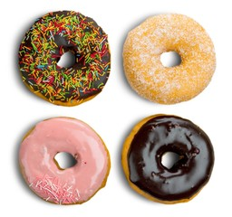 Different assorted donuts on background