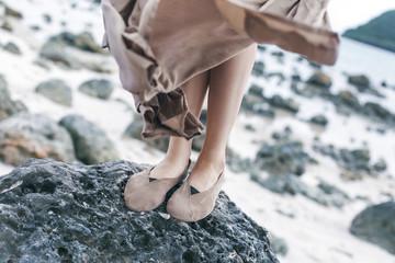 beautiful young stylish woman feet close up outdoors