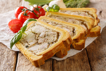 Chicken terrine in bread sliced into pieces close-up. horizontal