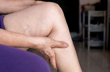 Woman with pain in the calf muscles,Female hand touching painful her leg
