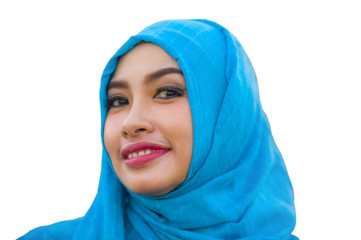 lifestyle isolated portrait of young beautiful and happy Asian woman smiling covered by muslim hijab head scarf in islamic culture and religion concept