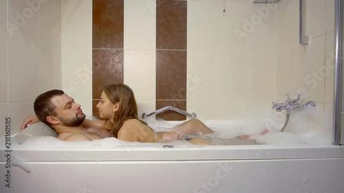 Couple In Love Having Fun During Romantic Bath Stock