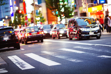 Cars moving on the urban road at dusk in Tokyo. Transport in the city