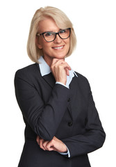 senior businesswoman wearing glasses and smiling