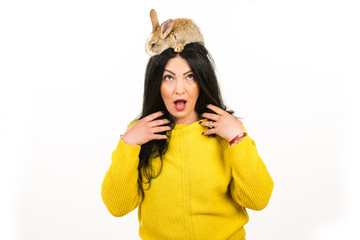 Surprised woman with bunny in her hair