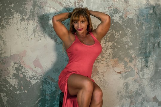 Hot sexy mature fit athletic woman demonstrates her body. Concept of sport, bodybuilding and women beauty, other beauties. Middle aged american or european lady