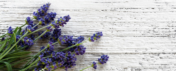 Lavender on wooden background top view