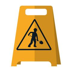 plastic caution emblem and laborer with shovel
