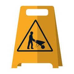 plastic caution emblem and laborer with wheelbarrow