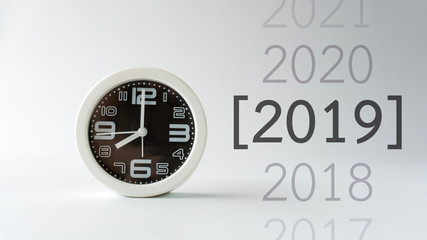 Clock background on gray color wall with year 2019 text