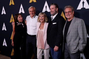 """Director of the movie Kleiser and cast members Conn, Pearl, Newton-John and Travolta pose at a 40th anniversary screening of """"Grease"""" at the Academy of Motion Picture Arts and Sciences in Beverly Hills"""