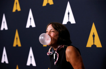 "Cast member Conn blows a bubble gum at a 40th anniversary screening of ""Grease"" at the Academy of Motion Picture Arts and Sciences in Beverly Hills"