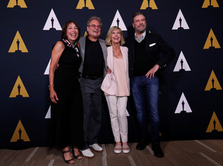 """Cast members Conn, Pearl, Newton-John and Travolta pose at a 40th anniversary screening of """"Grease"""" at the Academy of Motion Picture Arts and Sciences in Beverly Hills"""
