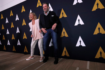 "Cast members Travolta and Newton-John dance at a 40th anniversary screening of ""Grease"" at the Academy of Motion Picture Arts and Sciences in Beverly Hills"