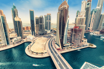 Photo sur cadre textile Moyen-Orient Aerial daytime skyline of Dubai Marina, UAE, with skyscrapers in the distance. Scenic travel background.