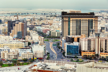 Aerial view on Deira City Center in Dubai, UAE, on a summer day. Travel background.