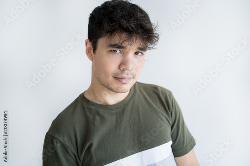 Portrait of confident young Asian man looking at camera. Vietnamese ...