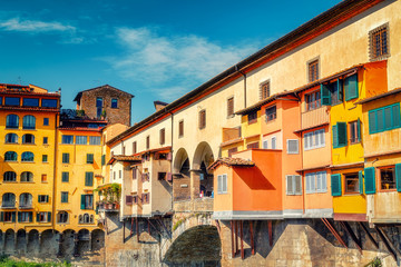 Ponte Vecchio in Florence, Italy on a summer day. Multicolored travel and architectural background.