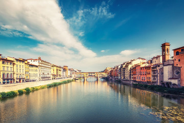 Fototapete - Scenic view on Ponte Vecchio in Florence, Italy, on a summer day with dramatic clouds. Travel background.