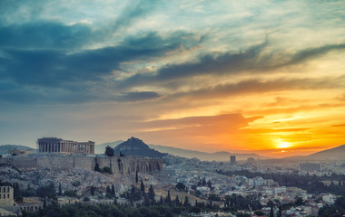 Wall Mural - View on Acropolis in Athens, Greece, at sunrise. Scenic travel background with dramatic sky.