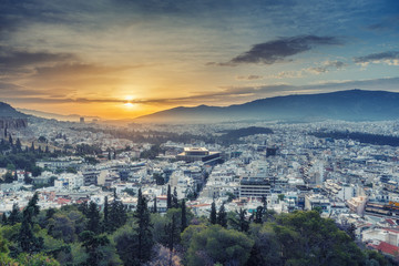 Panorama view on Athens, Greece, at sunrise. Scenic travel background with dramatic sky.