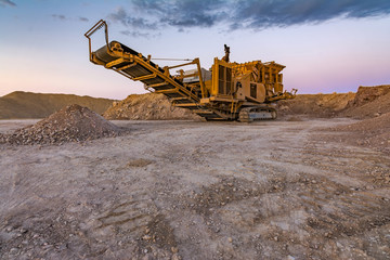 Stone crusher machine in a quarry or open-pit mine, to transform into gravel Wall mural