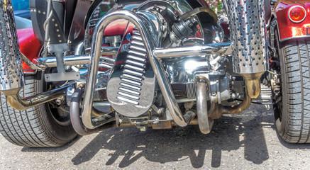 Chromed engine block of a trike.