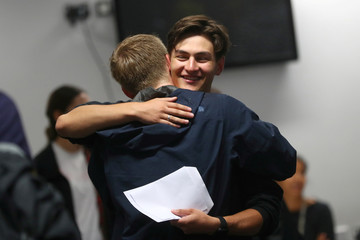 Students react as they receive their 'A' level results at Stoke Newington School and Sixth Form in London
