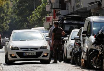 A policeman checks a car outside the home of U.S. pastor Andrew Brunson in Izmir