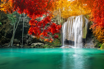Amazing beauty of nature, waterfall at colorful autumn forest