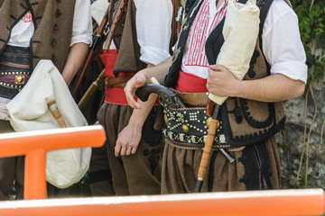 traditional costume in bulgaria, Belt and gun attached .