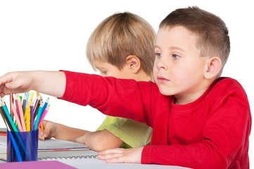 Two School Children Drawing on Notebooks