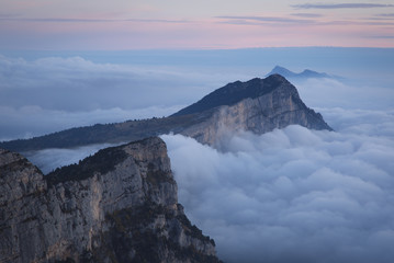 Fotomurales - A sea of clouds in the mountains at dawn. Vercors, France.