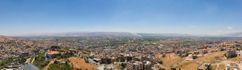 Panorama of the agricultural Bekaa Valley in Lebanon, with Antilebanon mountains in the back, from Zahlé town.