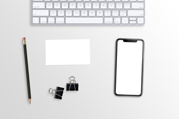 Wall Mural - Phone and business card mockup on white office desk. Keyboard, poster clips and pencil beside.