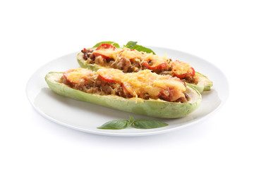 Plate with meat stuffed zucchini boats on white background