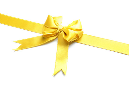 Yellow satin ribbon with bow on white background