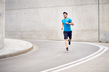 Foto op Canvas Jogging Health and fitness concept. Muscular man jogging in the city during workout session