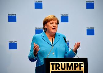 German Chancellor Angela Merkel speaks during her visit to the Saxony branch of Trumpf in Neukirch