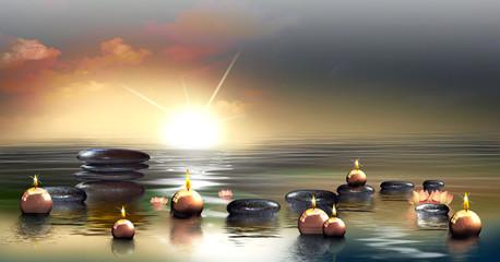 Wandbild mit Deko Steinen im Wasser und schwimmenden Kerzen