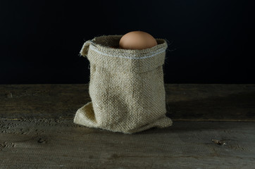 egg in sack on the cloth floor
