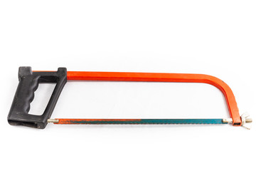 red hacksaw on a white background in studio