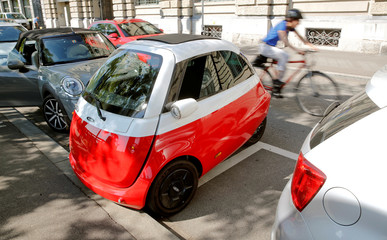 An electric-powered Microlino car of Swiss Microlino AG is parked in Zurich