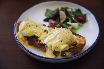 Egg benedict , poached eggs with toast on wood background , English Breakfast
