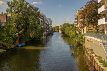 Picture from the river elster in leipzig .It is a popular place of residens in modern architectur in old and new buildings  .This is a beautiful place for watersports.