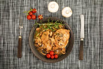 Braised pork chop with mushrooms.