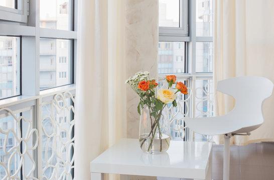 roses in vase on white table