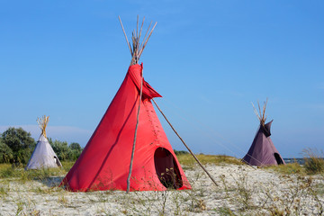 Three Indian wigwams lodge or teepee at the seashore at summer. travel concept. copyspace