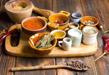 Kitchen spices on a wooden background