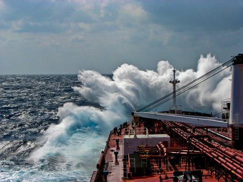 Waves in the Atlantic Ocean, strong wind, the tanker is flooded with water.